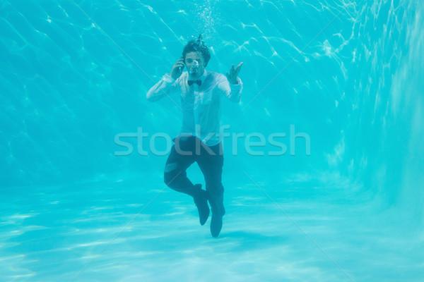 Jonge man zwemmen onderwater portret gelukkig Stockfoto © wavebreak_media