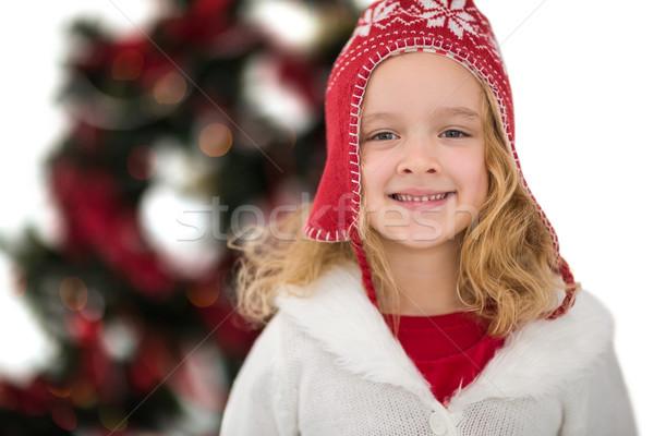 Festive little girl in hat and scarf Stock photo © wavebreak_media