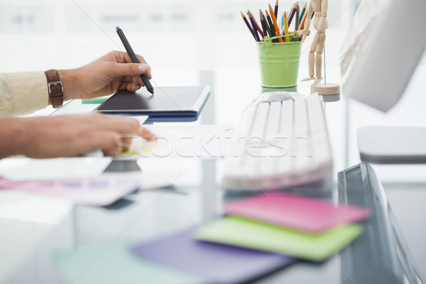 Stock photo: Designer working at desk using digitizer