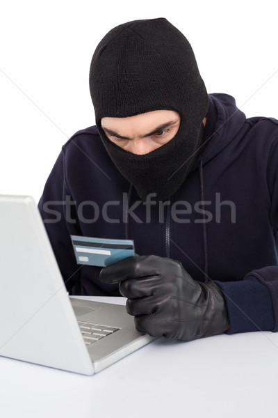 Mérges hacker laptopot használ hitelkártya fehér számítógép Stock fotó © wavebreak_media