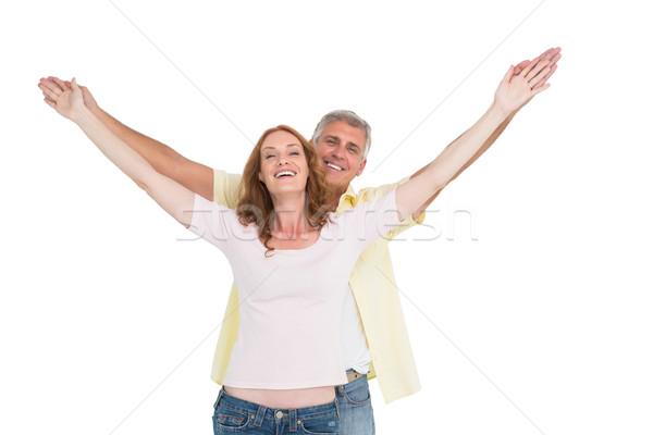 Lezser pár mosolyog karok a magasban fehér nő Stock fotó © wavebreak_media