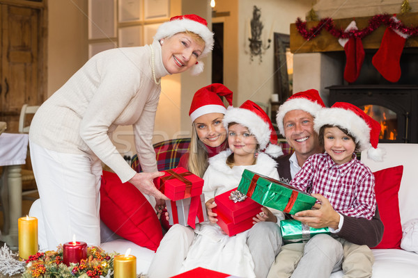 Smiling grandmother giving gift to her family Stock photo © wavebreak_media