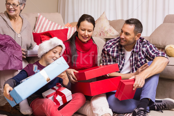 Happy family opening christmas gifts together Stock photo © wavebreak_media