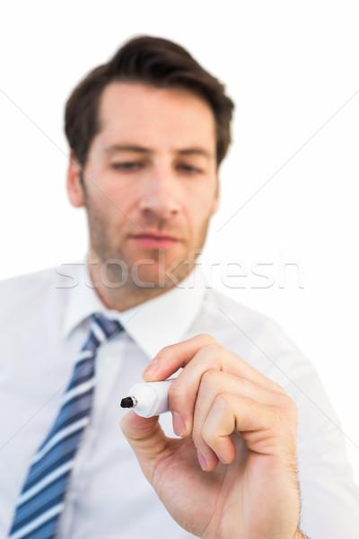 Koncentruje biznesmen piśmie znacznik biały człowiek Zdjęcia stock © wavebreak_media