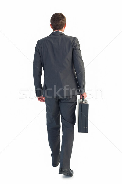 Işadamı yürüyüş evrak çantası beyaz adam kurumsal Stok fotoğraf © wavebreak_media