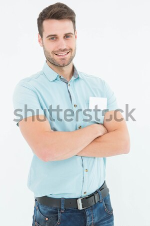 Delivery man standing arms crossed Stock photo © wavebreak_media
