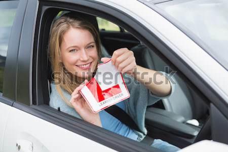 Vrolijk vrouwelijke bestuurder omhoog teken Stockfoto © wavebreak_media