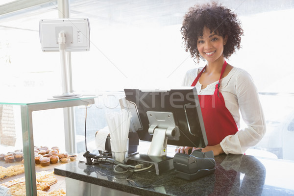 Beautiful waitress posing behind the counter Stock photo © wavebreak_media