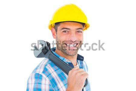 Smiling manual worker holding adjustable spanner Stock photo © wavebreak_media