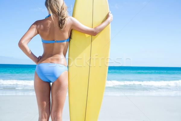 Pretty blonde woman holding surf board Stock photo © wavebreak_media