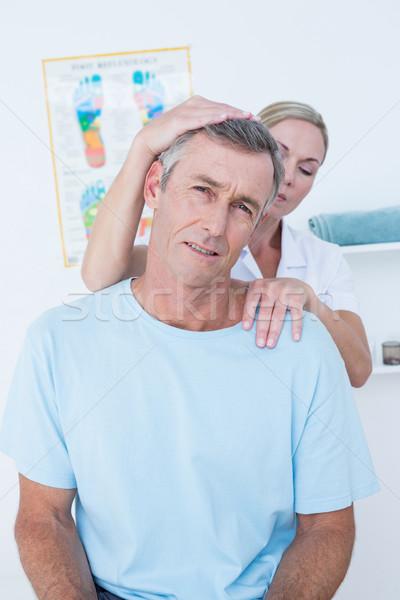 Orvos nyak beállítás orvosi iroda nő Stock fotó © wavebreak_media