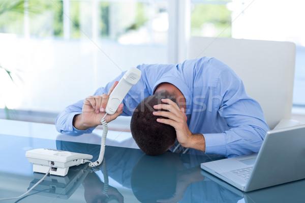 Deprimido empresario teléfono oficina negocios hombre Foto stock © wavebreak_media