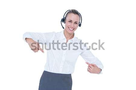 улыбаясь деловая женщина гарнитура указывая белый бизнеса Сток-фото © wavebreak_media