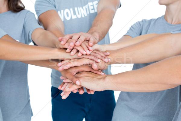 Voluntarios amigos manos junto feliz hombre Foto stock © wavebreak_media