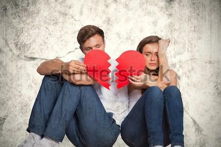 Young couple holding broken heart Stock photo © wavebreak_media