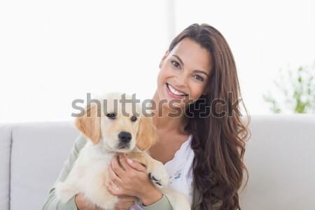 Sorridente mulher loira golden retriever casa sala de estar Foto stock © wavebreak_media