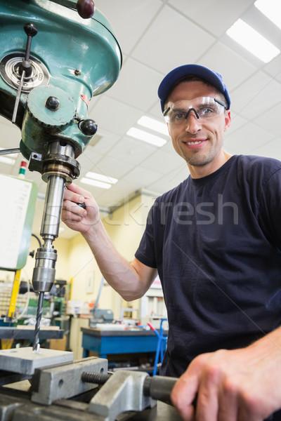 Inżynierii student wiercenia uczelni człowiek Zdjęcia stock © wavebreak_media