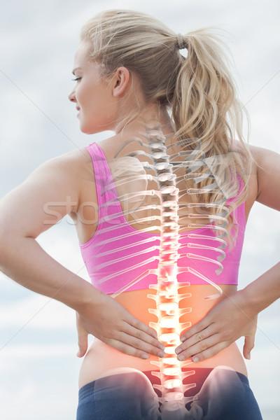 Coluna mulher dor nas costas composição digital água mar Foto stock © wavebreak_media