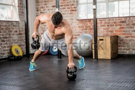 Composite image of shirtless man lifting kettlebell Stock photo © wavebreak_media