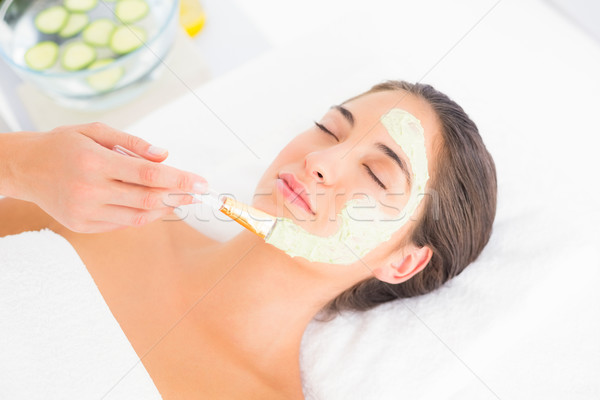 Beautiful brunette getting a facial treatment Stock photo © wavebreak_media