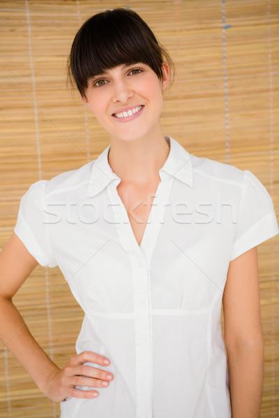 Smiling woman looking at he camera Stock photo © wavebreak_media