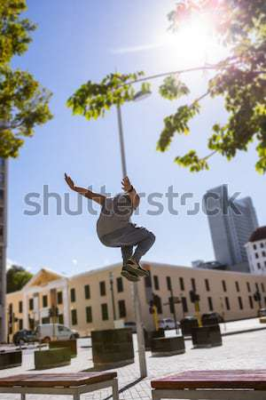 Happy friends doing parkour in the city Stock photo © wavebreak_media