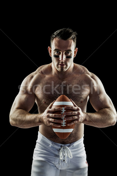 Shirtless American football player with ball Stock photo © wavebreak_media