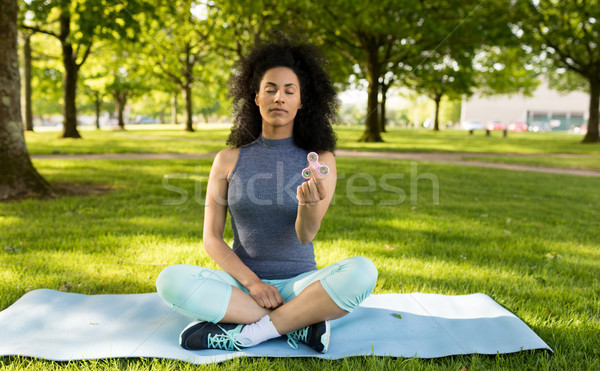Girl relaxing with fidget spinner Stock photo © wavebreak_media