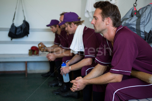 Side view of tired basball players sitting on bench Stock photo © wavebreak_media