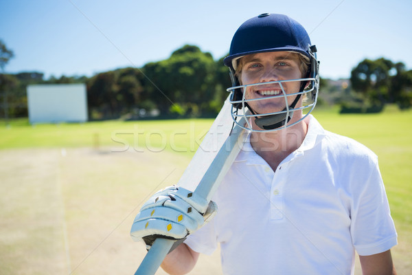 肖像 笑みを浮かべて クリケット プレーヤー バット ストックフォト © wavebreak_media