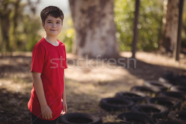 Stock photo: Portrait of smiling boy standing in boot camp