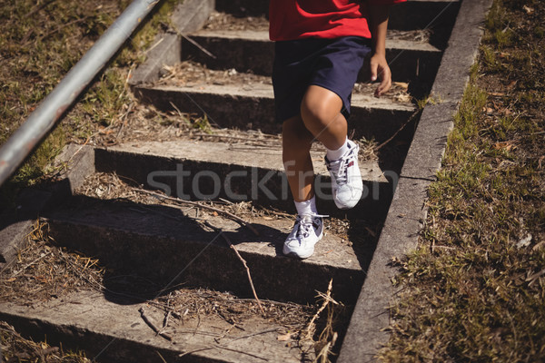 Low section of girl moving down satircase during obstacle course Stock photo © wavebreak_media