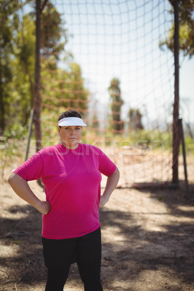 Portrait of woman standing with hands on hip in boot camp Stock photo © wavebreak_media
