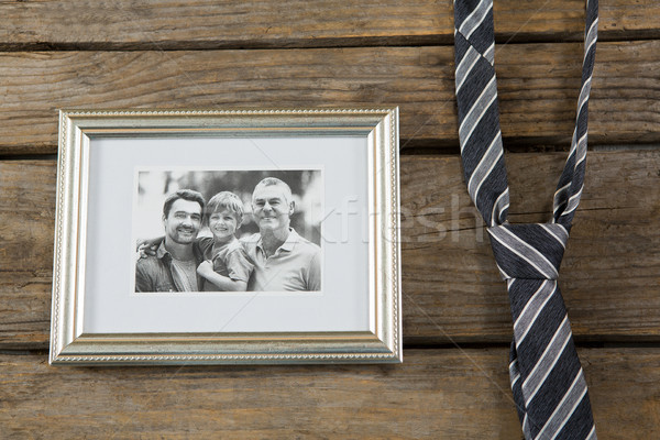 Overhead view of picture frame by necktie on table Stock photo © wavebreak_media