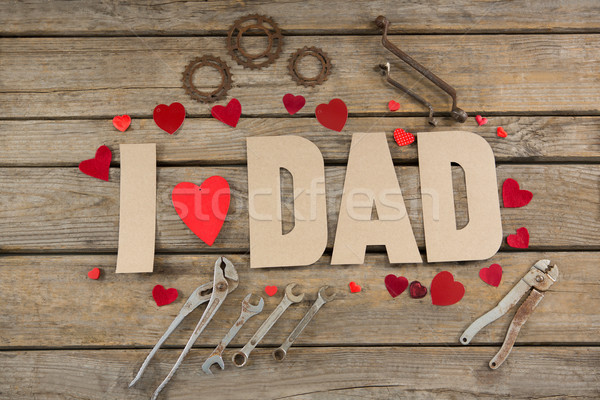 High angle view of text with hand tools and heart shapes on table Stock photo © wavebreak_media