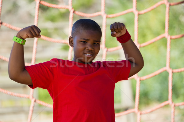 Boy standing in the boot camp during obstacle course training Stock photo © wavebreak_media