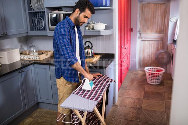 Side view of young man ironing shirt Stock photo © wavebreak_media