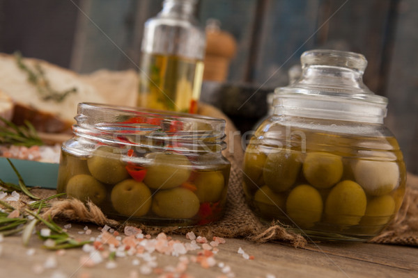 Close up of green olive in glass jars Stock photo © wavebreak_media