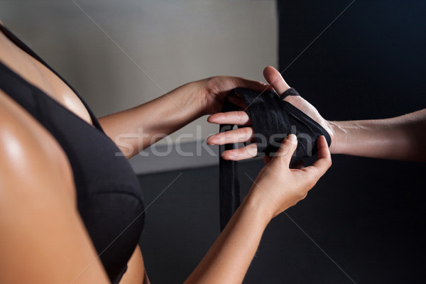Trainer trying hand wrap on womans hand Stock photo © wavebreak_media