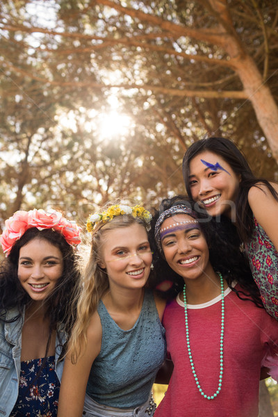 Portrait of smiling young female friends against trees Stock photo © wavebreak_media