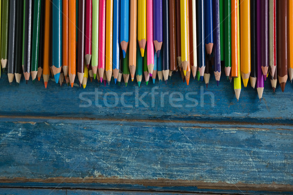 Various color pencils arranged on wooden table Stock photo © wavebreak_media