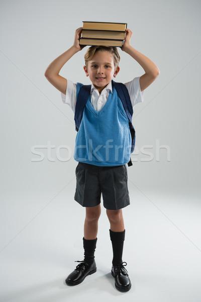 Colegial libro cabeza retrato escuela Foto stock © wavebreak_media