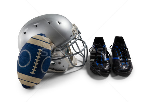 High angle view of American football with sports shoes and helmet Stock photo © wavebreak_media