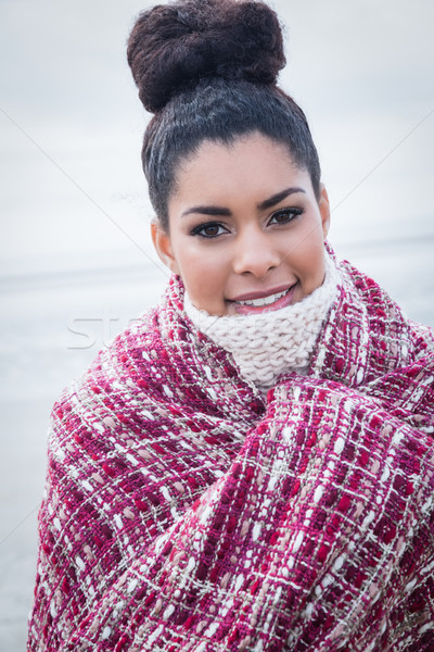 Beautiful woman wrapped up in warm clothing Stock photo © wavebreak_media