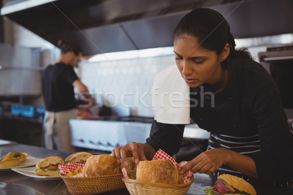 Waitress arranging baskets with food in cafe Stock photo © wavebreak_media