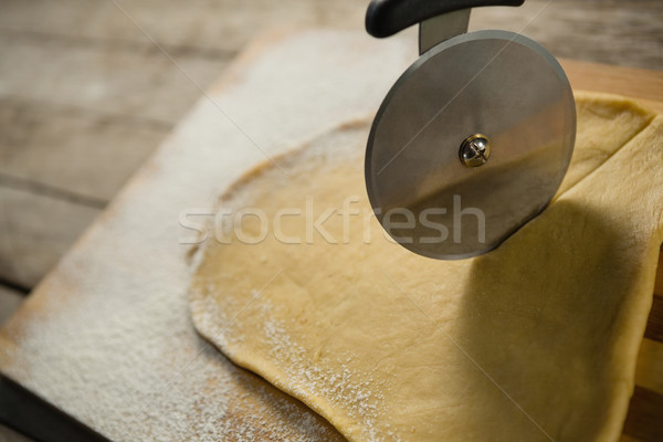 Cropped image of cutter cutting pastry dough Stock photo © wavebreak_media