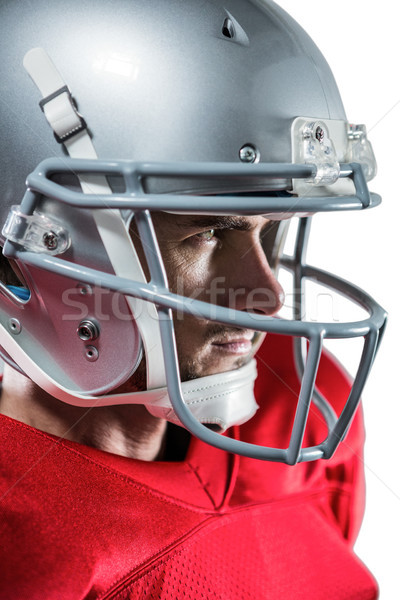 Serious American football player in red jersey looking away Stock photo © wavebreak_media