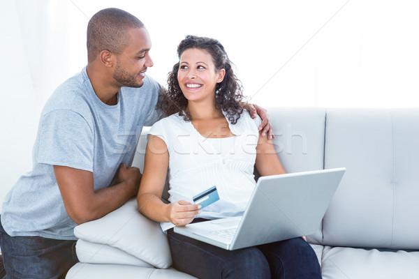 Happy couple shopping online Stock photo © wavebreak_media