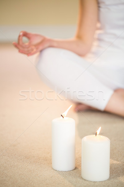 Low section of woman in yoga pose with illuminated candles  Stock photo © wavebreak_media