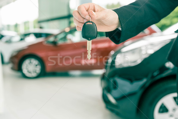 Saleswoman holding a car key Stock photo © wavebreak_media